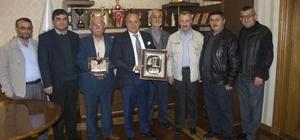 Şehit ailelerinden Kaymakam Yüksel ve Başkan Arslan'a ziyaret