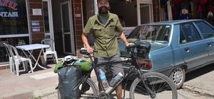 Çin'den bisiklet ile ülkesi İsviçre'ye gidiyor