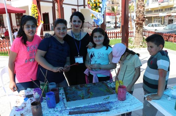 Muzaffer İzgü, Germencik 2. Kültür Sanat Çalıştayında söyleşi gerçekleştirdi