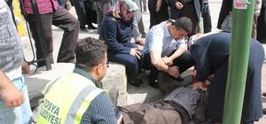 Kaymakam koruması kriz geçiren yaşlı adamı yere düşerken yakaladı