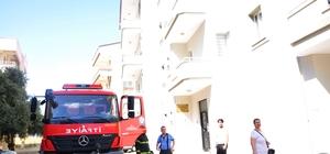 Milas'ta 10 aylık bebek yanan evden kurtarıldı