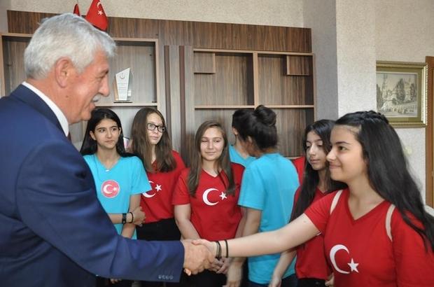 'Bizim Türkümüz' heyeti Müdür Elmalı'yı ziyaret etti