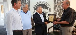 Mahalle muhtarlarından Başkan Büyükkılıç'a plaketli teşekkür ziyareti