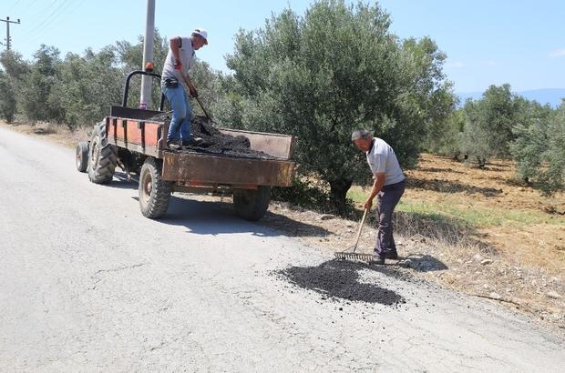 Burhaniye'de yağmurun bozduğu yollar tamir ediliyor