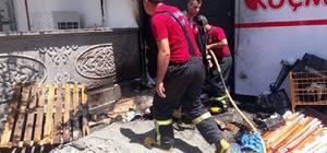 Yangın markete sıçramadan söndürüldü