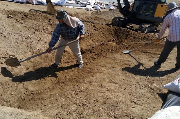 Yayladağı'nda su taşkınlarını önlemek için göletler onarılıyor