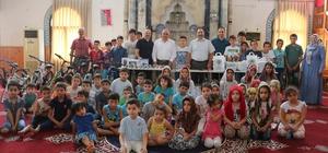 Başkan Tollu'dan Kur'an öğrenen çocuklara hediye