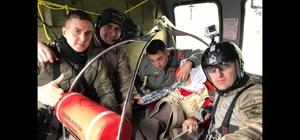 Toprak altından kurtarılan kadın helikopterle hastaneye ulaştırıldı