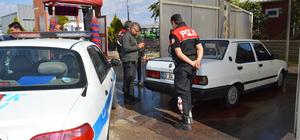 Çaldığı iddia edilen otomobili yıkarken yakalandı