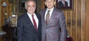 Prof. Dr. Serdar Sevimli ve TRT Türk Halk Müziği Sanatçısı Yavuz Değirmenci Rektör Çomaklı'yı ziyaret etti