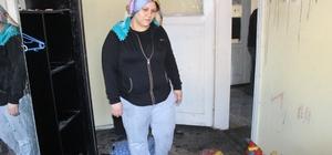 Evi yanan kadın 2 çocuğuyla yardım bekliyor