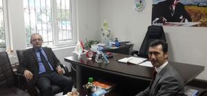 Burhaniye'de Kaymakam Öner'den İlçe Müdürü Orhan'a hayırlı olsun ziyareti
