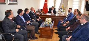 Davutoğlu'ndan ilçe teşkilatlarına ziyaret