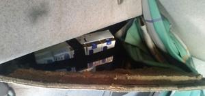 Aracın gizli bölmelerinden bin 350 paket kaçak sigara çıktı