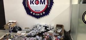 Mersin'de bit pazarına operasyon: 10 gözaltı Mersin'de Zafer Çarşısı'na düzenlenen operasyonda, cinsel içerikli hap, kaçak sigara, dolu makaron, sigara likidi, kaçak elektronik sigara gibi 24 bin 469 gümrük kaçağı malzeme ele geçirildi