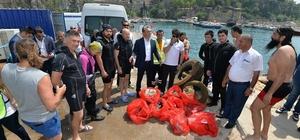 Denizden çıkanlar şok etti Tarihi Kaleiçi Yat Limanı'nda denizden 10 çuval atık çıktı Belediye Başkanı Akdeniz'in derinliklerinde çöp topladı Cam şişeler, petler, kamyon lastiği bile var Deniz dibinden çıkartılan atıklar Pazar günü sona erecek çevre festivalinde sergilenecek