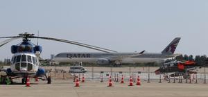 Dünyada bir tane, ilk kez Türkiye'de Eurasia Airshow'un gösteri uçuşları mest etti Dünya havacılık sektörünün enlerini Antalya'da buluşturmaya hazırlanan Türkiye'nin şova dayalı ilk havacılık fuarı Eurasia Airshow kapsamında dev uçaklar Antalya Havalimanı'na geldi Askeri ve gösteri uçaklarını şov denemeleri ilgiyle izlenirken, dünyada sadece bir tane olan Qatar Airways'e ait Airbus A350-1000 yolcu uçağı da alandaki yerini aldı