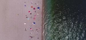 Antalya'da 30 dereceyi gören denize koştu