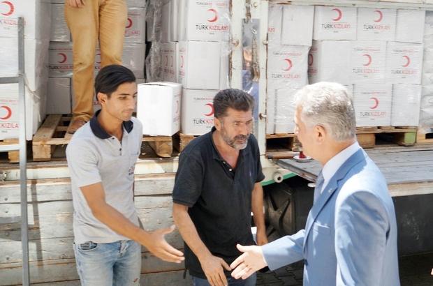 """MHP'li Büyükataman ziyaret ettiği Kızılay'da kolilerin taşınmasına yardım etti MHP Genel Sekreteri İsmet Büyükataman: """"2023 yılında lider ülke hedefimize bu sistem sayesinde inşallah geçme imkanı bulacağız"""""""
