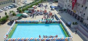 Mahalleye kurulan havuzla lisanslı sporcu oldular Kayyum Vali, yetenekli çocukları spora kazandırdı