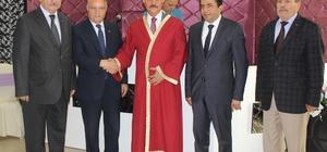 Bursalı esnaflar Büyükataman'ı siyasetin ustası ilan etti Şed kuşanan Büyükataman usta ilan edildi