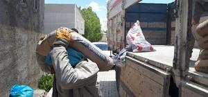 Yapımı devam eden cami, Kur'an kursu ve taziye evlerine malzeme yardımı