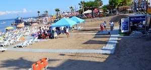 Didim Belediyesinde anlamlı açılışlar Medusa heykeli açıldı, engelsiz plajı faaliyete girdi