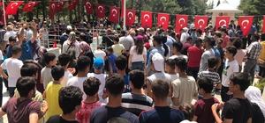 Tatvanlı sporcular Halisdemir'i mezarı başında andı