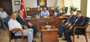 """Dinçer: """"Vergide yapılandırma fırsatını kaçırmayın"""" Vergi Dairesi Başkanı Adem Güngör ve grup müdürleri, Mersin ESOB Yönetim Kurulu Başkanı Talat Dinçer'e hayırlı olsun ziyaretinde bulundu"""