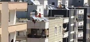 Şanlıurfa'da akıllara durgunluk veren olay Anahtarı evde unutunca çocuğunu çatıdan balkona sarkıttı