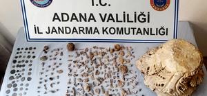Adana'da tarihi eser kaçakçılarına operasyon İki evde yapılan aramada 1 işlemeli taş sütun, 68 metal sikke ve 49 taş eser bulundu