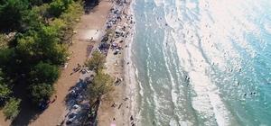 Dilek Yarımadası'nda ormanla iç içe plaj keyfi Kavurucu sıcaklarla Dilek Yarımadası Milli Parkı'nda yoğunluk hat safhaya ulaştı
