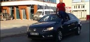 Arabayı tavanına oturup kullanan sürücüye ceza
