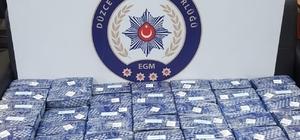 Düzce polisinden uyuşturucu operasyonu Otomobilin zulasından 80 kilo eroin ele geçirildi
