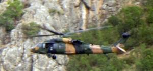 Beytüşşebap kırsalında hava hareketliliği Şehit Yarbay Songül Yakut operasyonunun sürdüğü Faraşin Yaylası'nda helikopter hareketliliği yaşandı