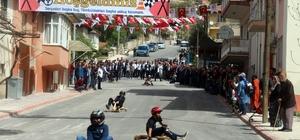 """Protokol üyeleri tahta arabalarla yokuş aşağı yarıştı Bucak'ta """"Tömbüldek Formula1 Yarışları"""""""