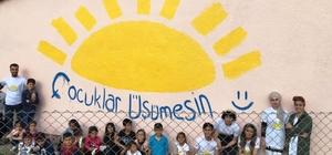 Köy okulunu boyattılar, çizgi film karakterleriyle süslediler Çocuklar Üşümesin Gönüllüleri köy okulunu boyadılar, sonra resimler çizerek süslediler