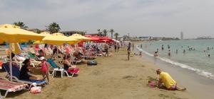 Mersin sahillerinde bayram tatili hareketliliği Tatili fırsat bilen vatandaşlar, 324 kilometrelik geniş bir sahil bandına sahip olan kentte denizin tadını çıkarıyor