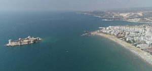 Mersin sahilleri doldu taştı Doğu Akdeniz'in tatil merkezi Mersin'de, 9 günlük Ramazan Bayramı tatili dolayısıyla turizmciler çifte bayram yaşadı