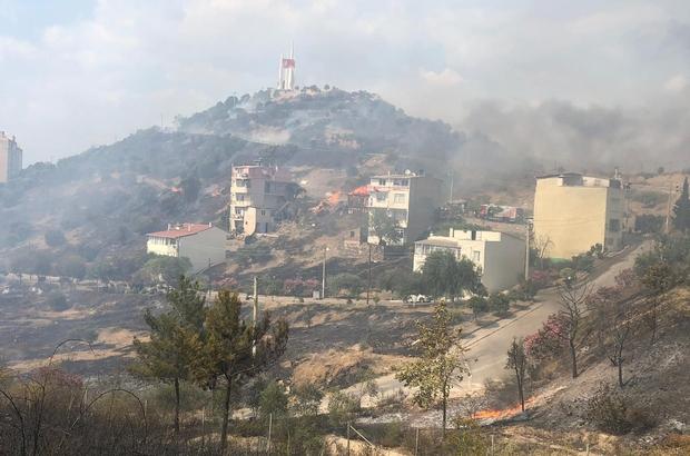 İzmir'de korkutan orman yangını: 2 eve sıçradı