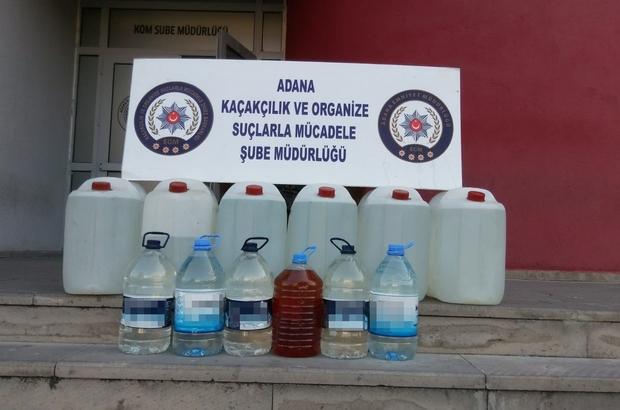 Adana'da kaçak içki operasyonu Kaçak içki imalathanesi olarak kullanılan evde 140 litre kaçak rakı ele geçirildi