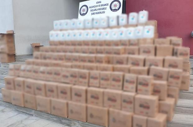 """Antifrizli su görünümlü etil alkol Adana'da bir depoda üzerinde """"antifrizli cam suyu"""" yazan 479 adet 5 litrelik bidonlarda etil alkol ele geçirildi"""