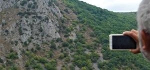 Dağ yüzeyindeki insan silueti dikkat çekiyor