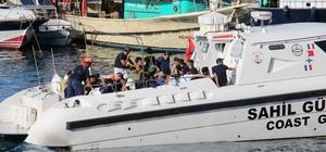 Şişme botla ölüm yolculuğuna çıkan göçmenler Sahil Güvenlik tarafından kurtarıldı Kaş'ta 6'sı çocuk 34 kaçak göçmen yakalandı