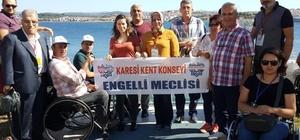Dünya rekortmeninden Bakan Selçuk'a deniz dibinde teşekkür pankartı Karesi engelli meclisi Ayvalık'ta düzenlenen etkinliğe katıldı
