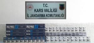 Kars'ta sigara kaçakçıların kurnazlığını jandarma yutmadı Jandarma kaçak sigarayı motor ve stepneden çıkardı
