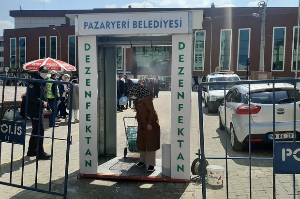 Halk pazarında vatandaşlar dezenfekte tünelinden geçerek, 25'şerli gruplar halinde içeri alındı