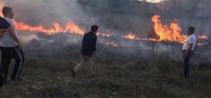 """Arazi yangınında kaymakam, belediye başkanı ve ilçe jandarma komutanı tehlike atlattı Yenipazar Belediye Başkanı İlhan Özden; """"Belediye iş makinesinin yanmaktan kurtarılması için çalıştığımız esnada yangın içinde kalma riskini beraberinde getirdi"""""""