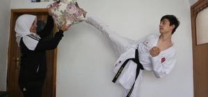 14 yaşındaki milli karateci antrenmanları halasıyla yapıyor Korona virüs nedeniyle evden çıkamayan milli karateci antrenmanlarını 53 yaşındaki halasıyla yapıyor