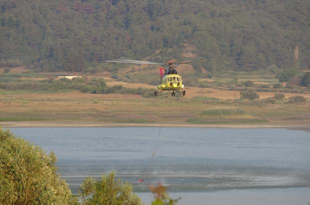 Gelibolu'da soğutma çalışmaları devam ediyor Helikopterler ardı adına sorti yaparak, soğutma çalışmalarını aralıksız sürdürüyor Türkiye tarihinin en büyük havadan orman yangını operasyonunda helikopterler önemli rol üstlendi